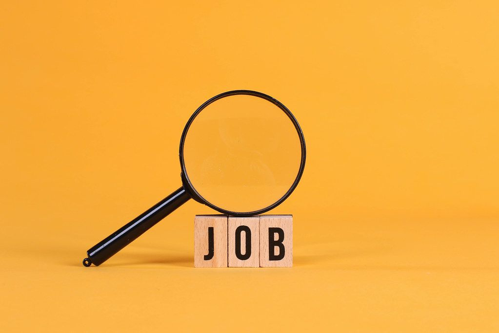 Magnifying glass with Job text on orange background