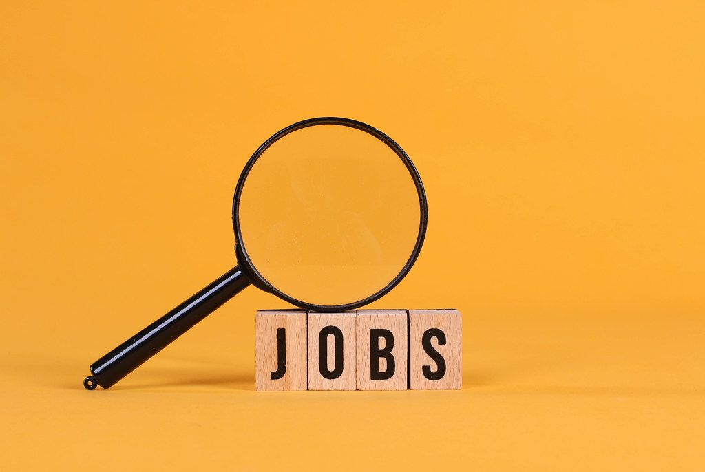 Magnifying glass with Jobs text on orange background