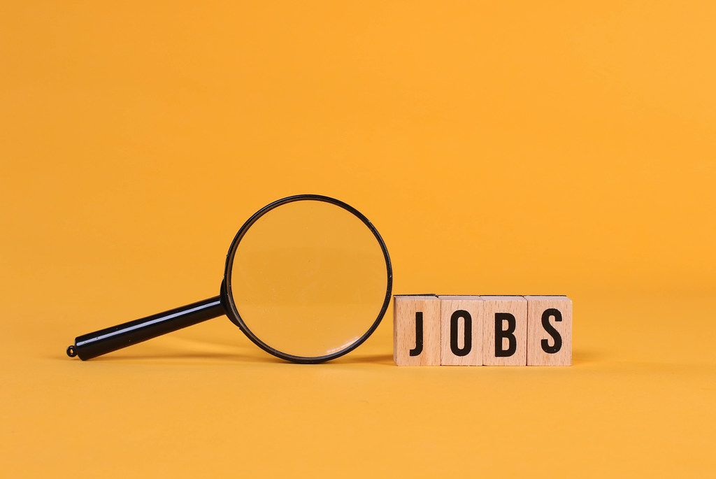 Magnifying glass with Jobs text