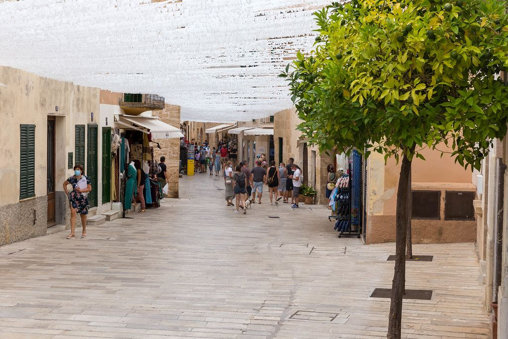 Majorca, summer 2020: tourists walking with face mask in Alcudía