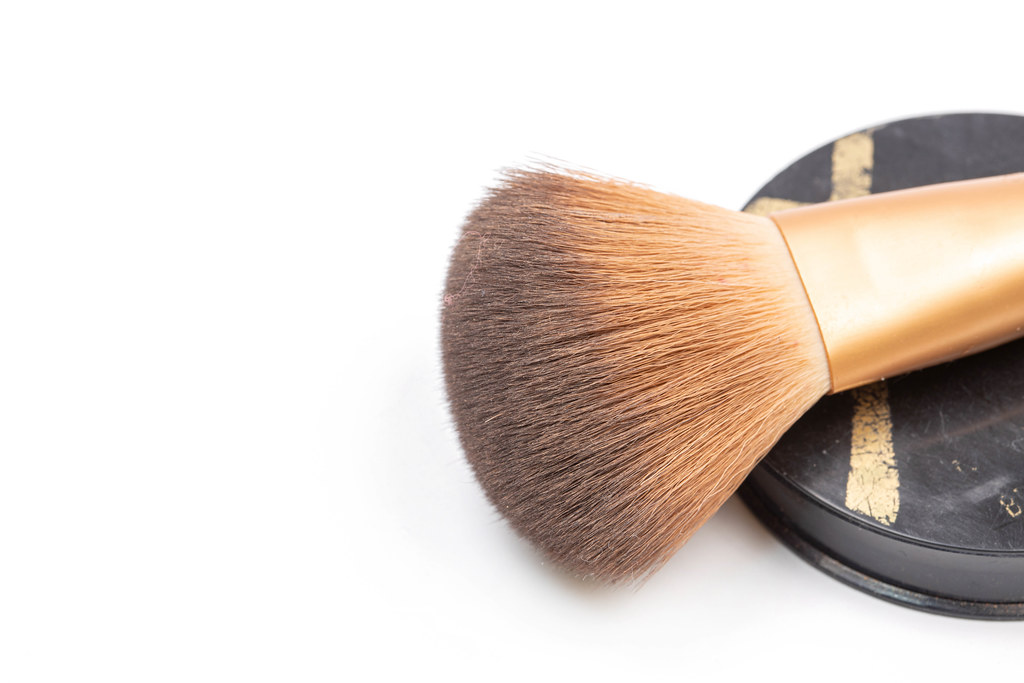 Makeup Brush with skin color Powder and copy space
