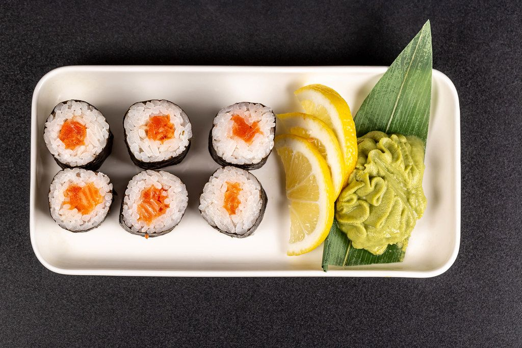 Maki rolls with salmon, wasabi and lemon, top view
