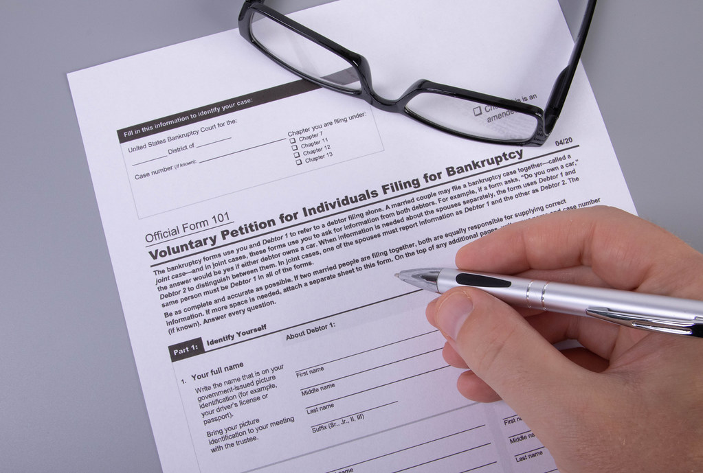 Man filling out Form 101 Voluntary Petition for Individuals Filing for Bankruptcy