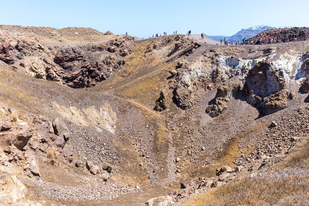Many tourists walk by the crater on the Greek island of Santorini: a must-see landscape