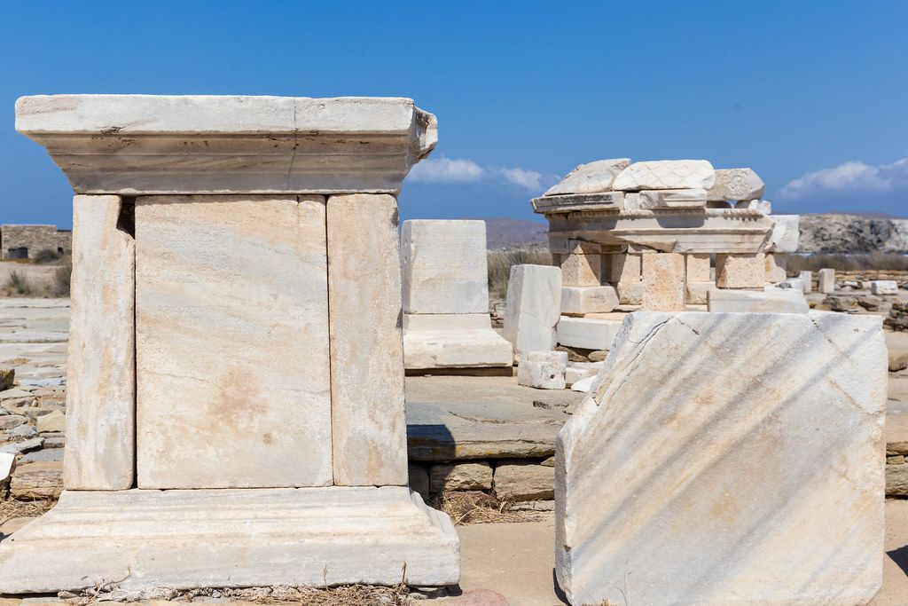 Marble stones: the ruins of the important archaeological site of Delos near Mykonos, Greece