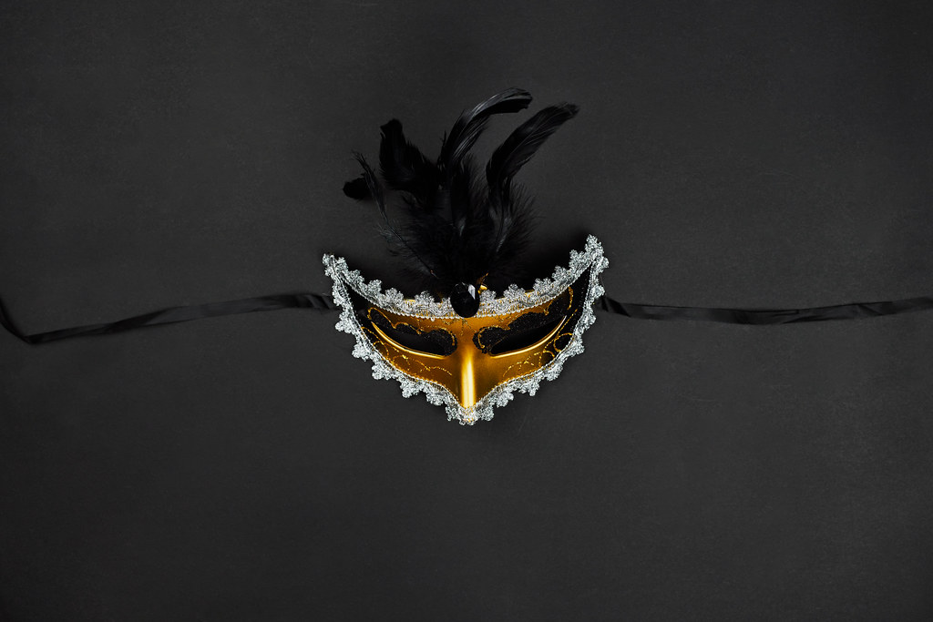 Masquerade venetian carnival mask with feathers