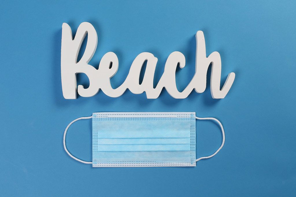 Medical face mask with Beach text on blue background