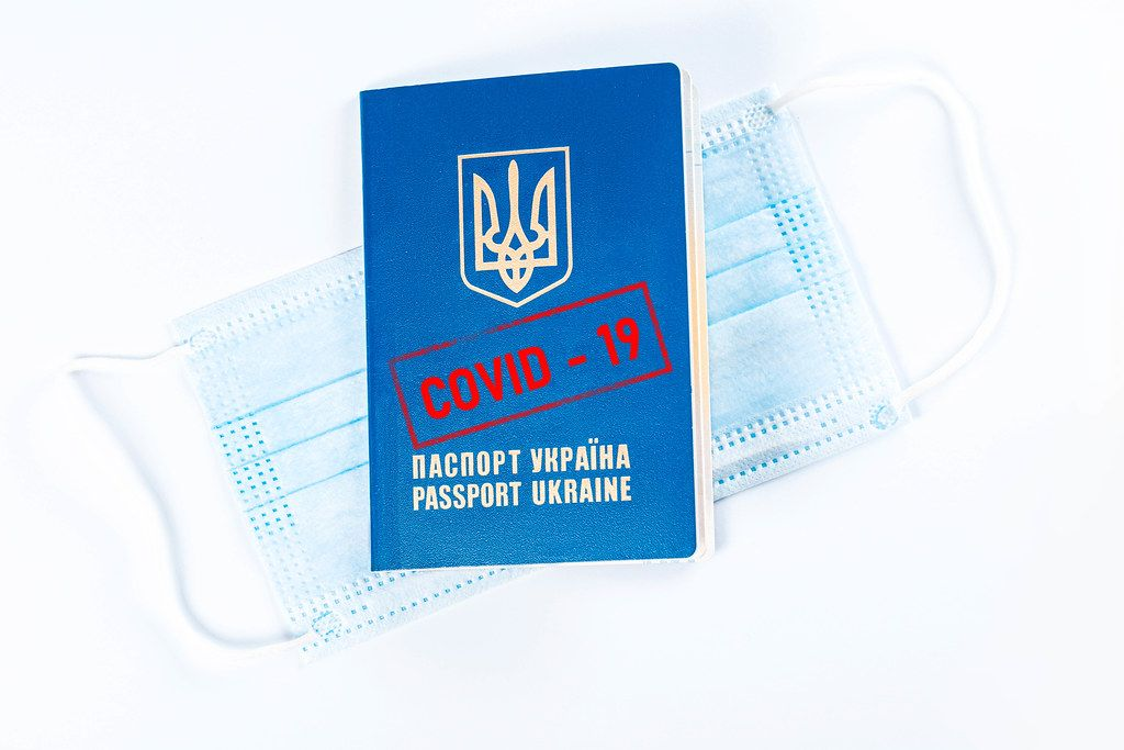Medical mask and passport with covid-19 stamp