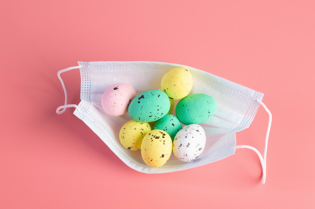 Medical protective face mask and colorful easter eggs