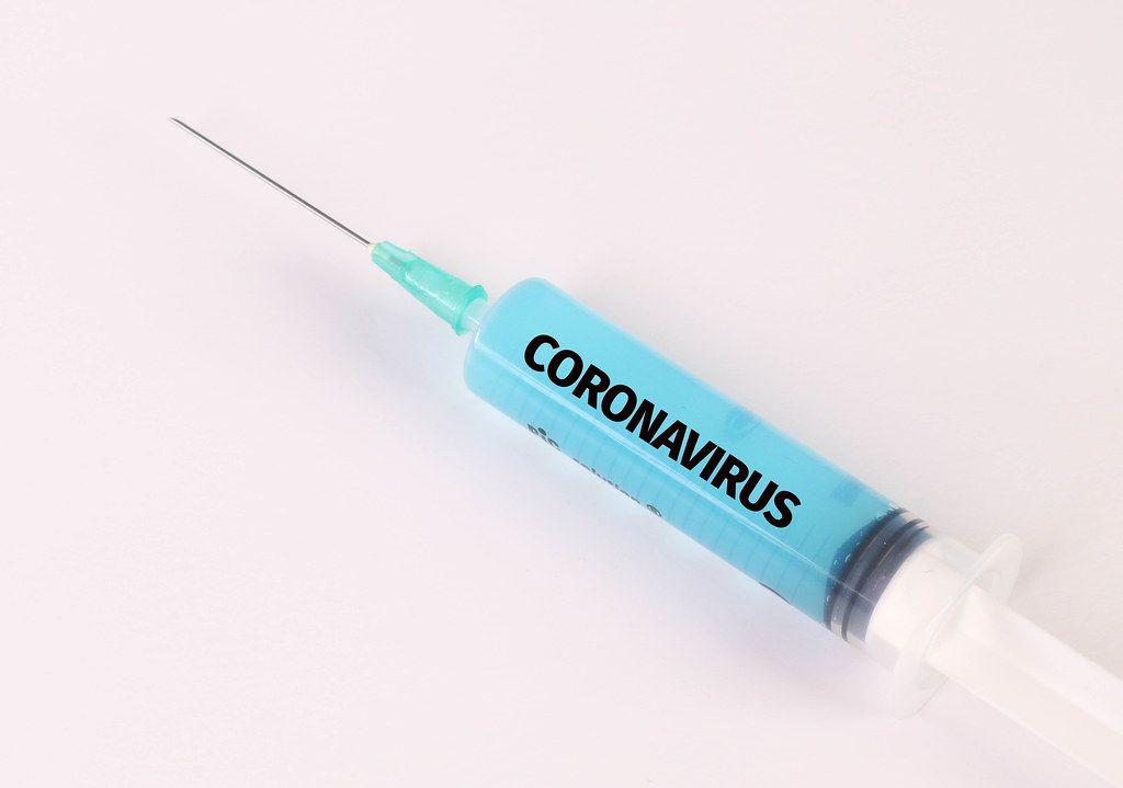 Medical syringe with Coronavirus text on it