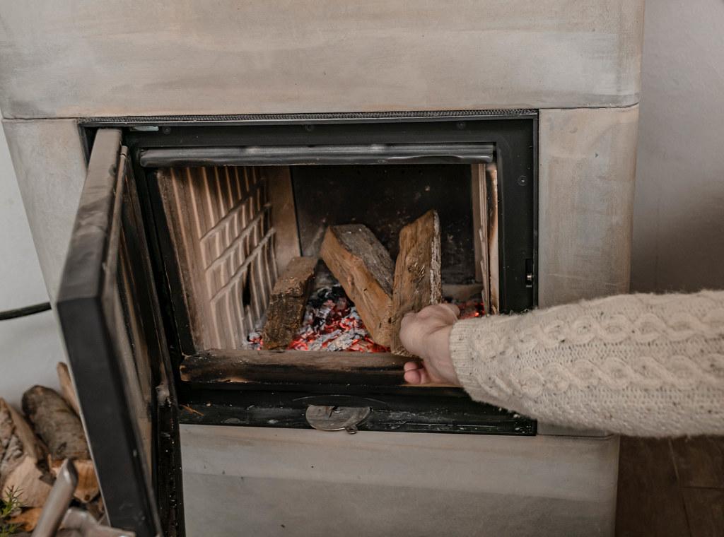 Men Setting  A Fire On Fireplace