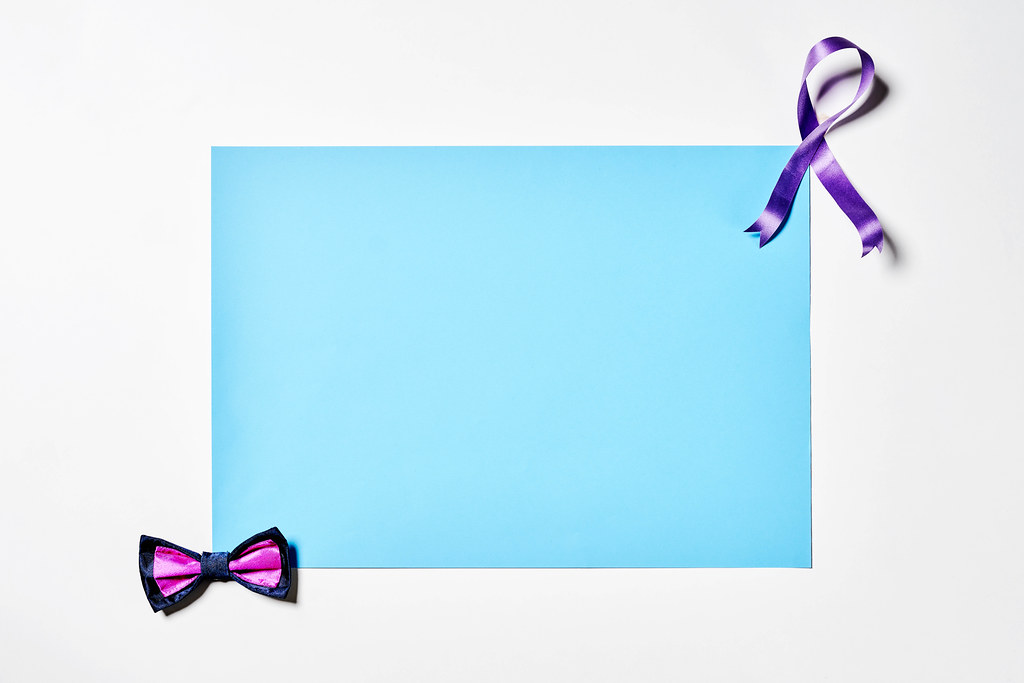Men's bow tie and ribbon with blank blue paper