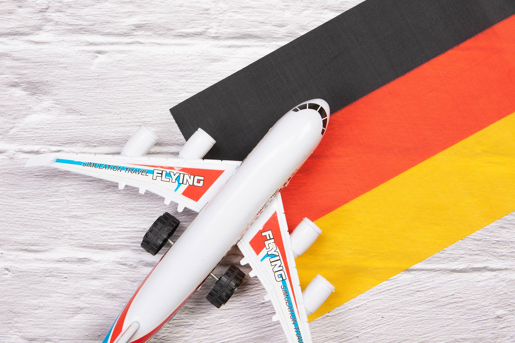 Miniature airplane over flag of Germany