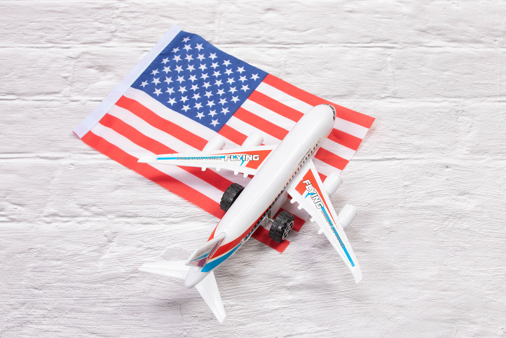 Miniature airplane over flag of USA