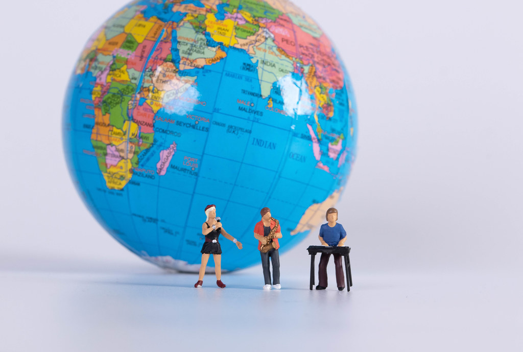 Miniature band with globe in the background