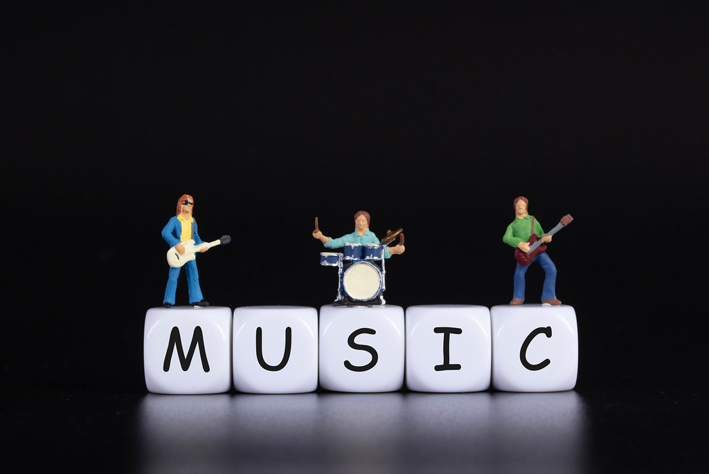 Miniature band with Music text