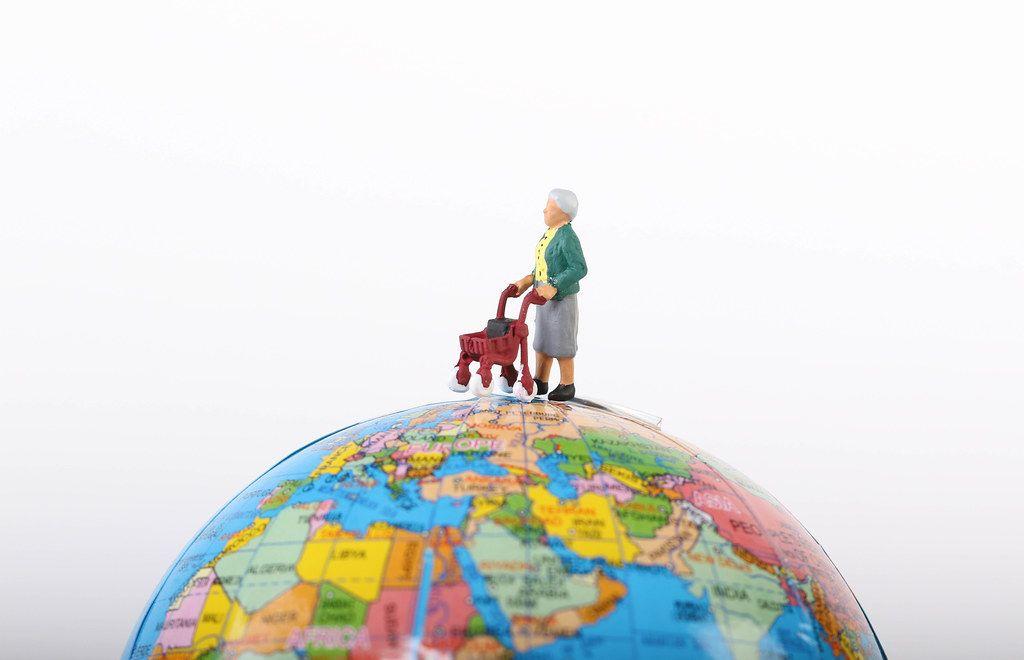 Miniature old woman on globe