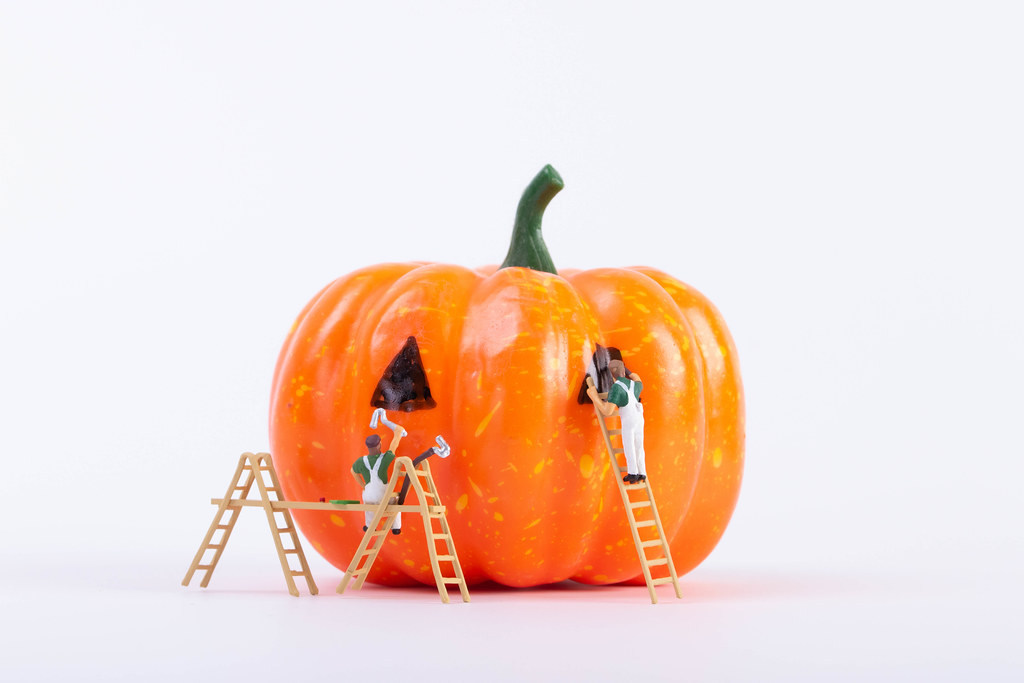 Miniature painters with Halloween pumpkin