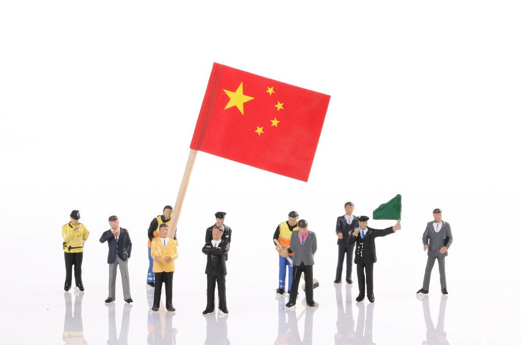 Miniature people with flag of China