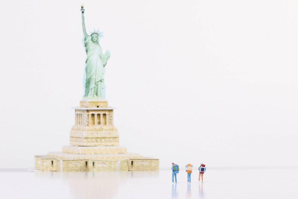 Miniature travelers and Statue of Liberty