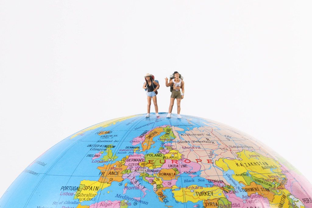 Miniature travelers on the globe