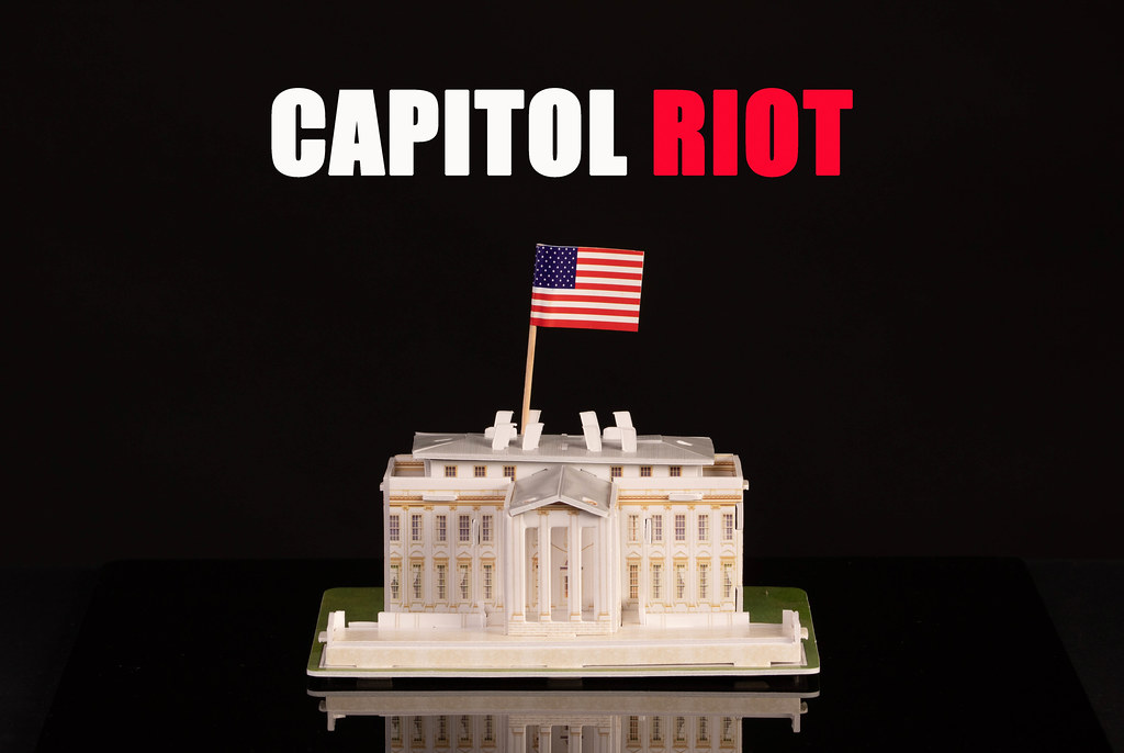 Miniature White House with American flag and Capitol Riot text