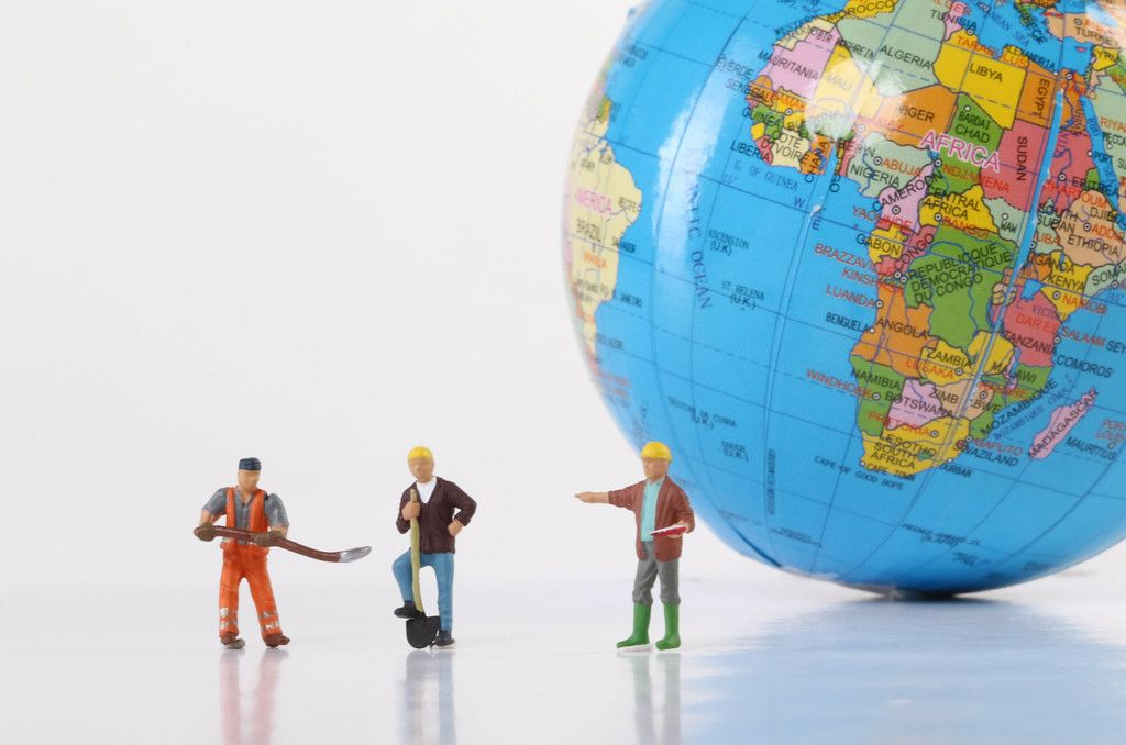 Miniature workers with globe