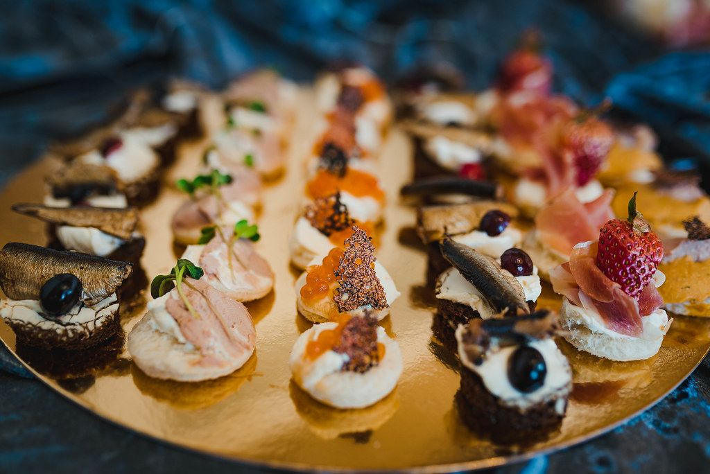 Mix Of Luxury Gourment Canapes With Herring, Cream, Fish Eggs And Prosciutto