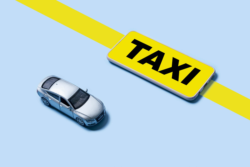 Mobile application of taxi service and miniature business class auto model