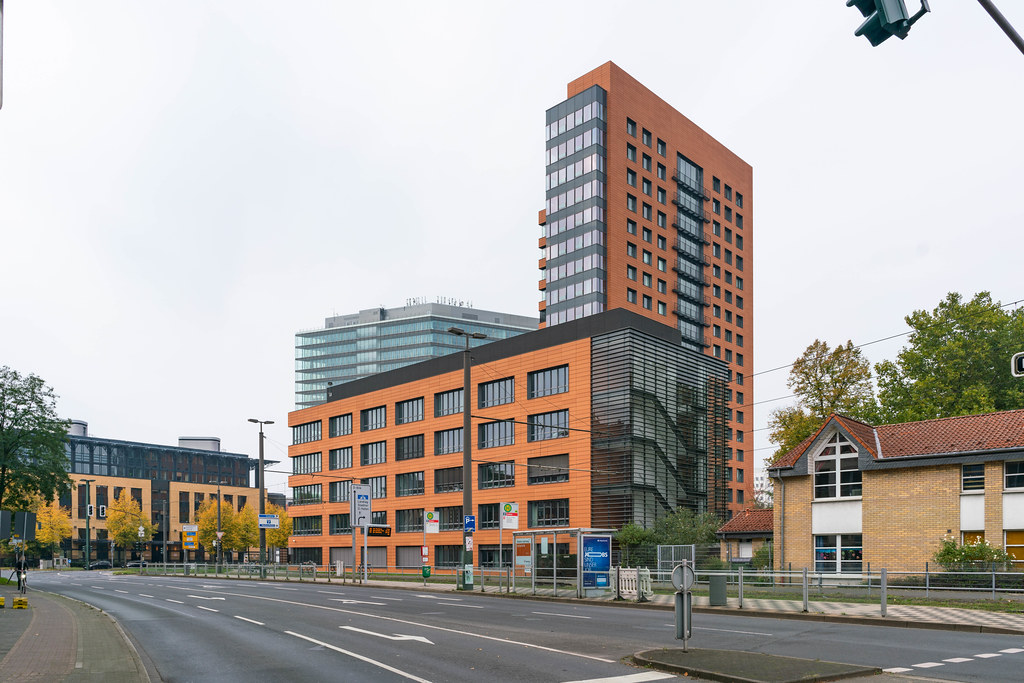 Moder orange office building near harbor in Düsseldorf, Germany