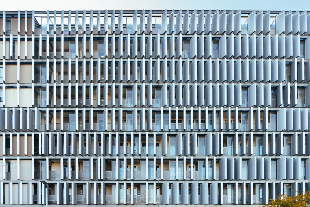 Modern looking building with multitude of panels over the facade in Amsterdam