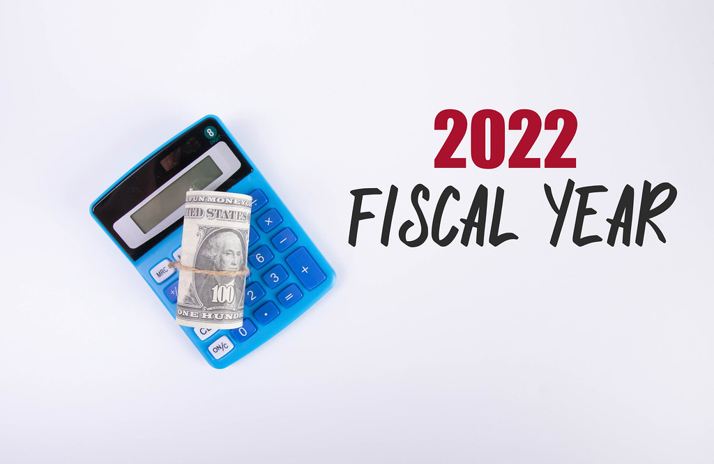 Money roll on a calculator and 2022 Fiscal Year text