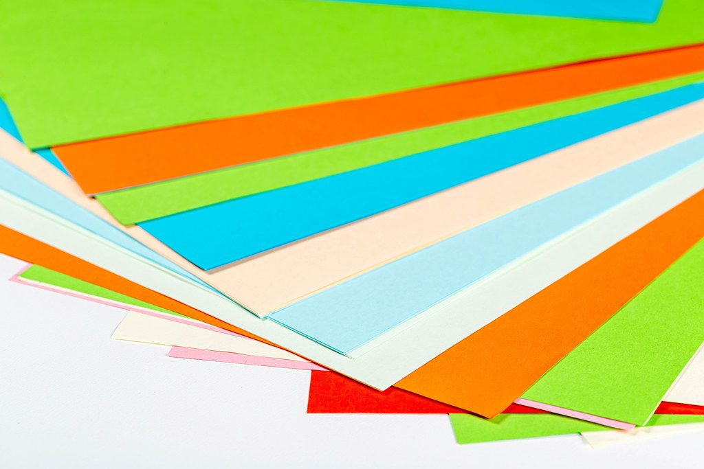 Multi colored paper on white background