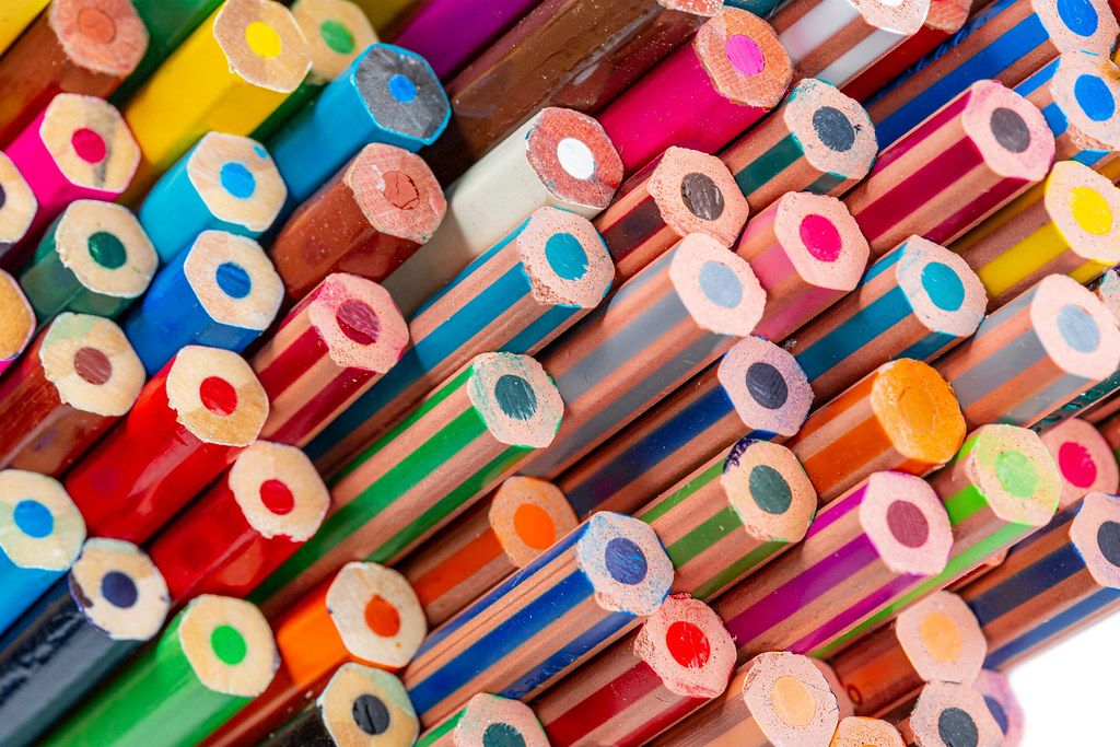 Multi colored pencils. School background