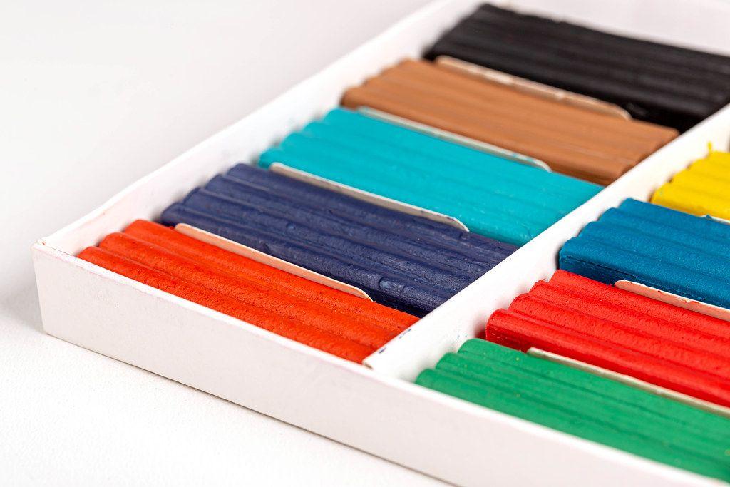 Multi-colored plasticine in a cardboard box, close-up