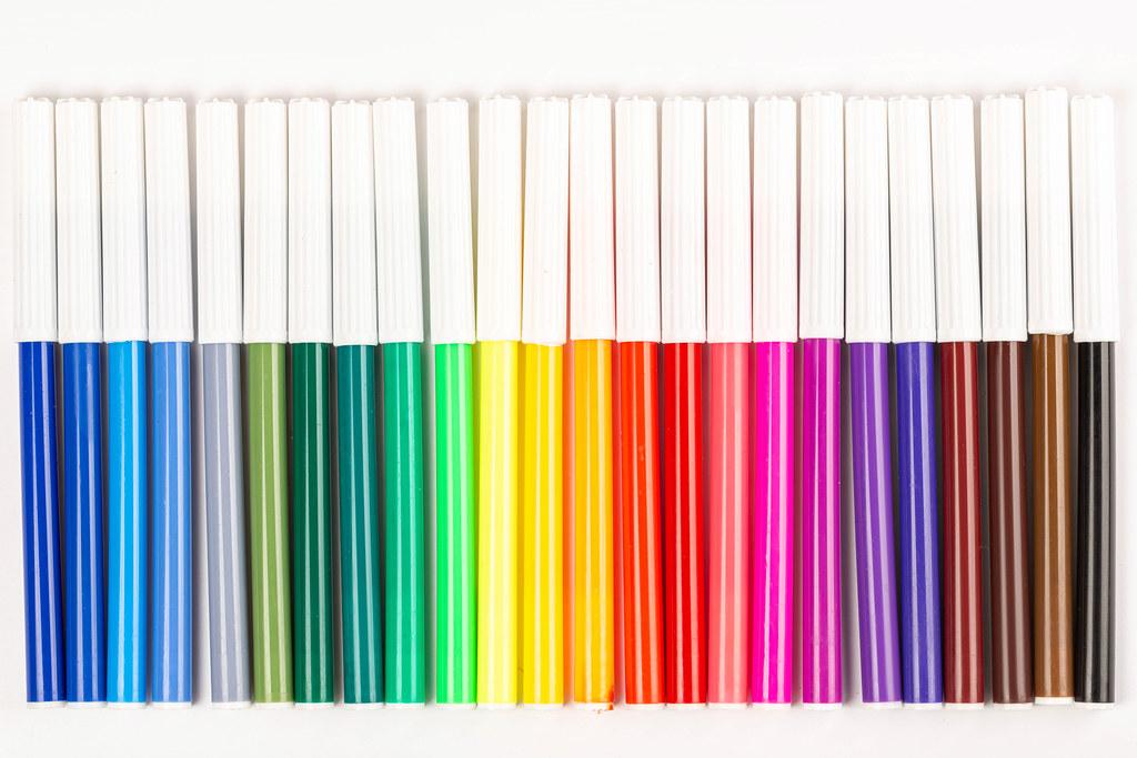 Multicolored felt tip pens on white