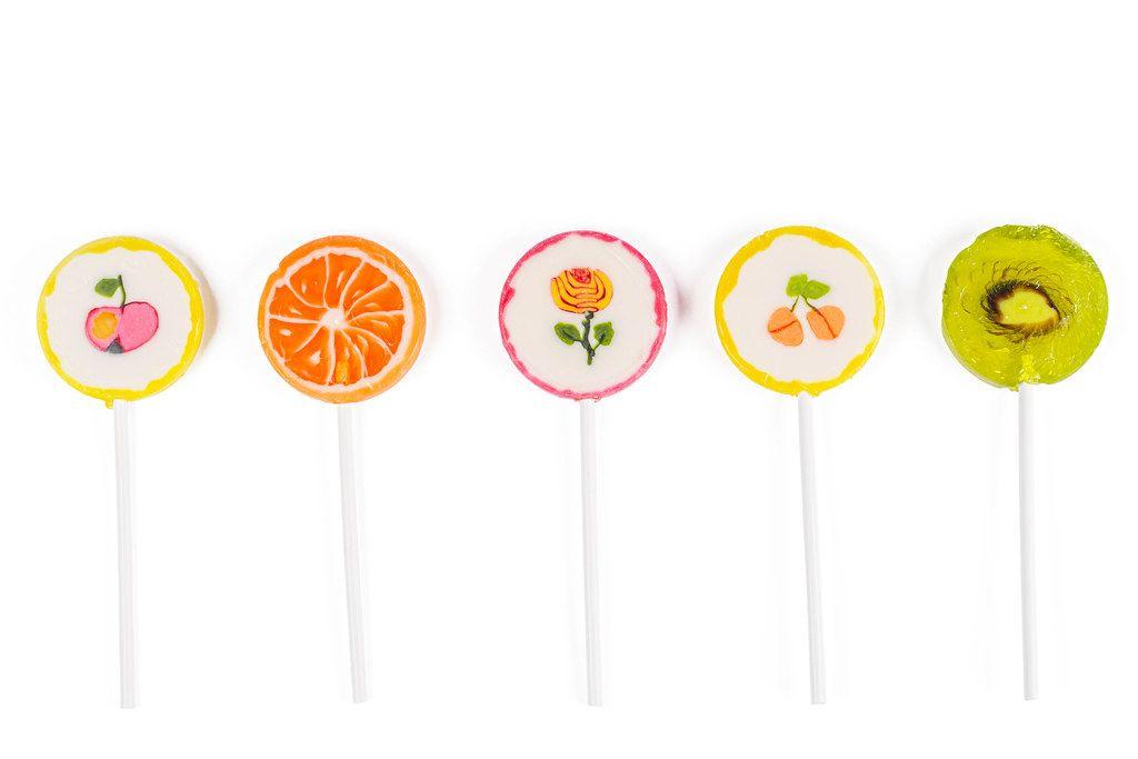 Multicolored lollipops on white background
