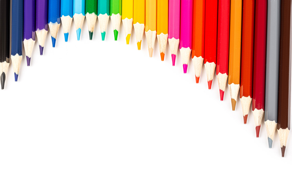 Multicolored pencils in white background with free space