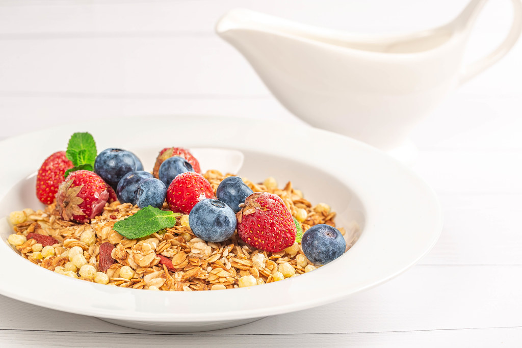 Multigrain breakfast with seeds, dried and fresh berries