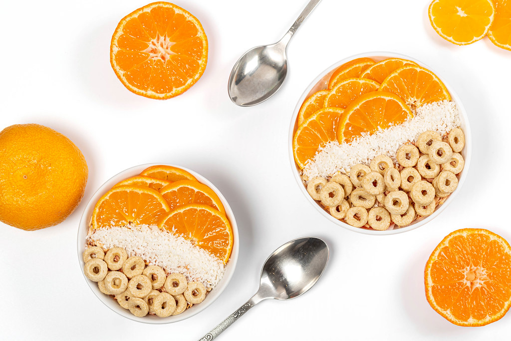 Multigrain breakfast with tangerines and coconut flakes, top view