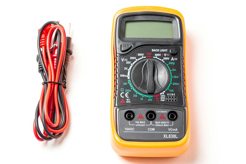 Multimeter with probes on white