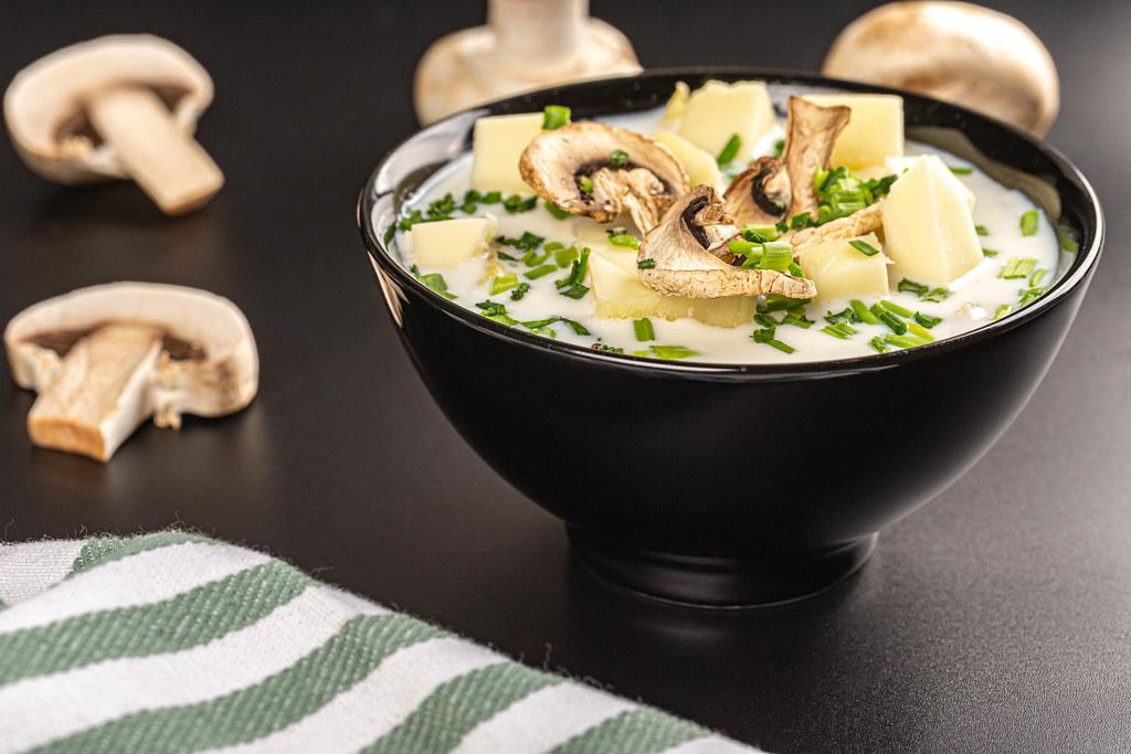 Mushroom soup in a black bowl