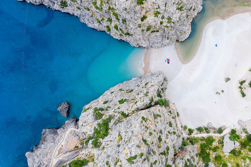 Must-see on Majorca: the remote, hidden beach of Sa Calobra with its canyon. Overhead shot