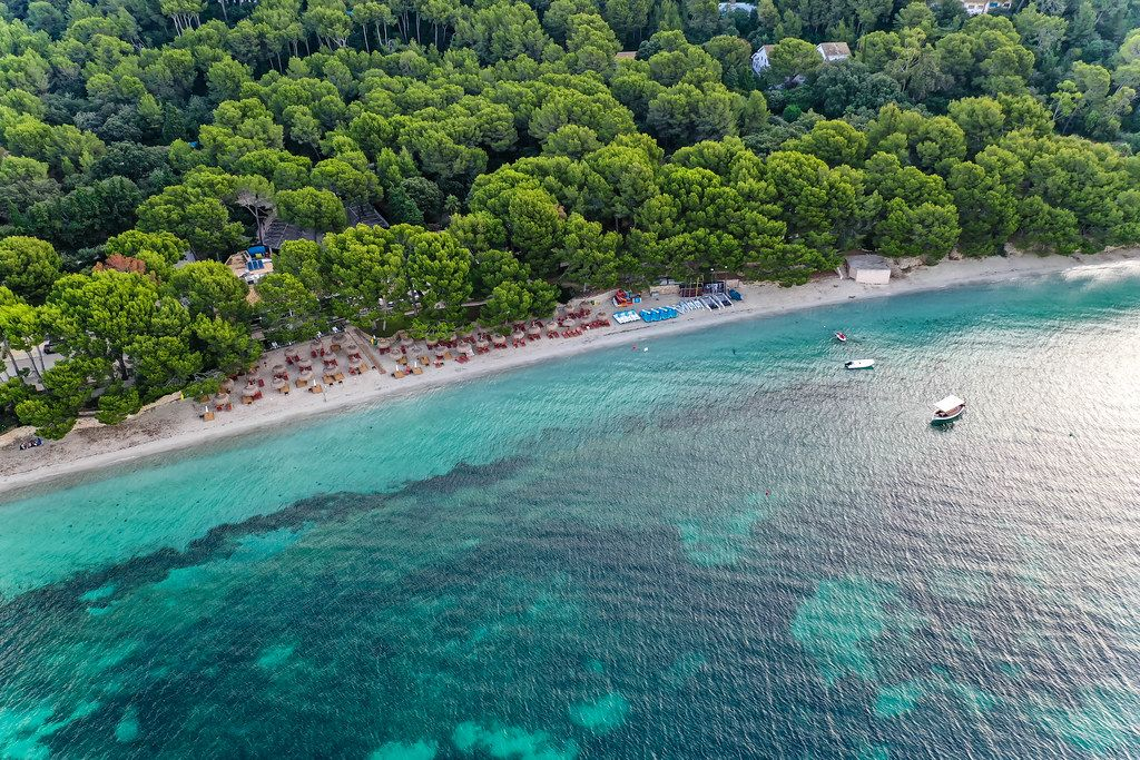 Narrow beach on Majorca, Balearic Islands: Playa de Formentor, Cala Pi de la Posada. Aerial view