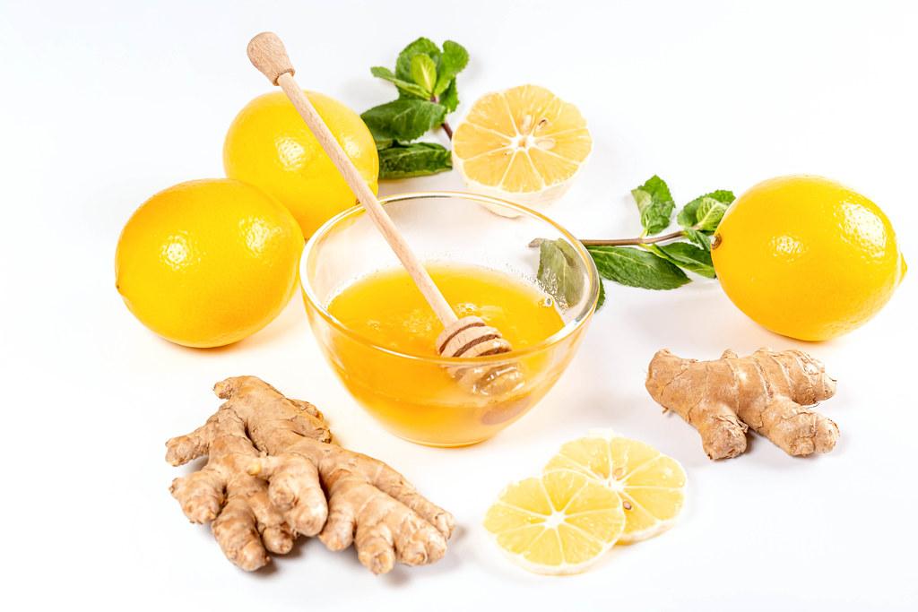 Natural medicine concept. Ginger, honey, lemon and mint