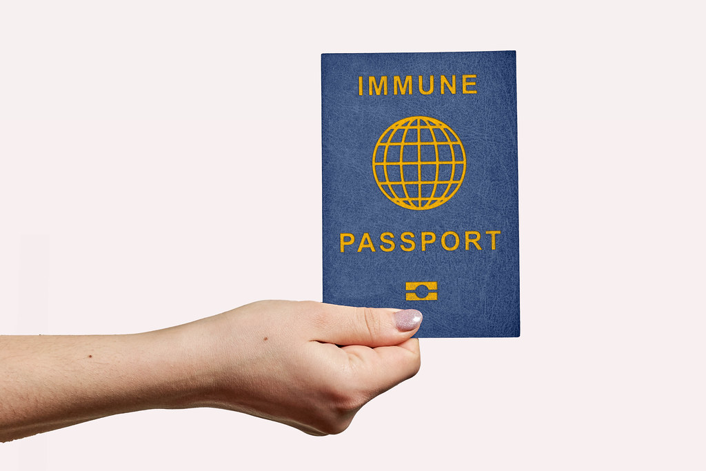 New immune passport in female hands