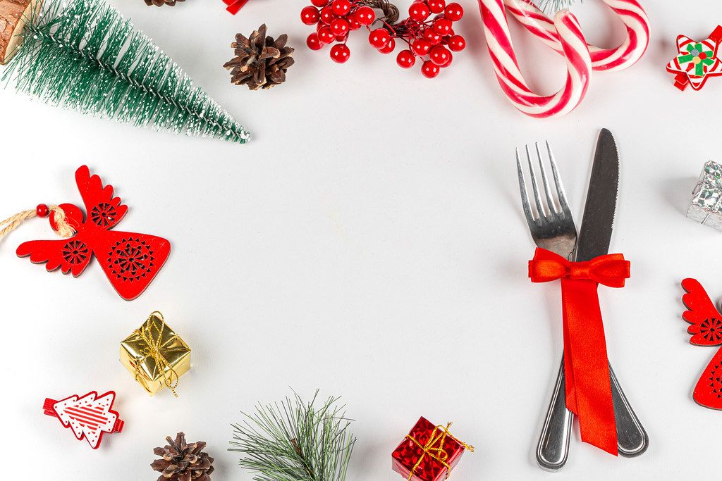 New year frame with knife, fork and christmas decor with free space