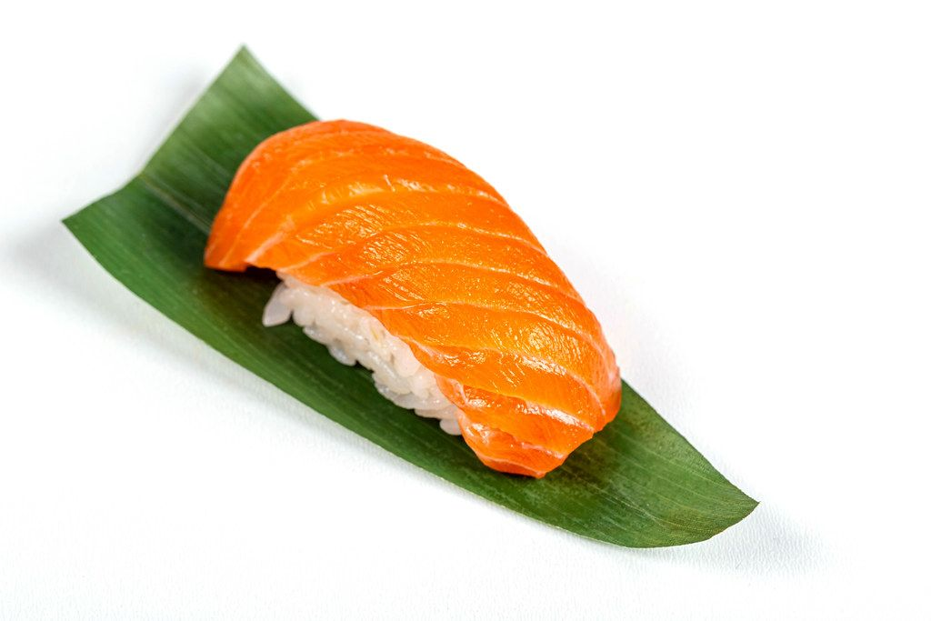 Nigiri with fillet salmon on a green leaf