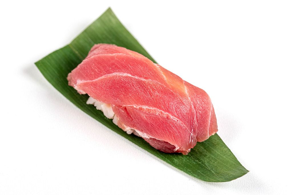 Nigiri with tuna fillet on a green leaf