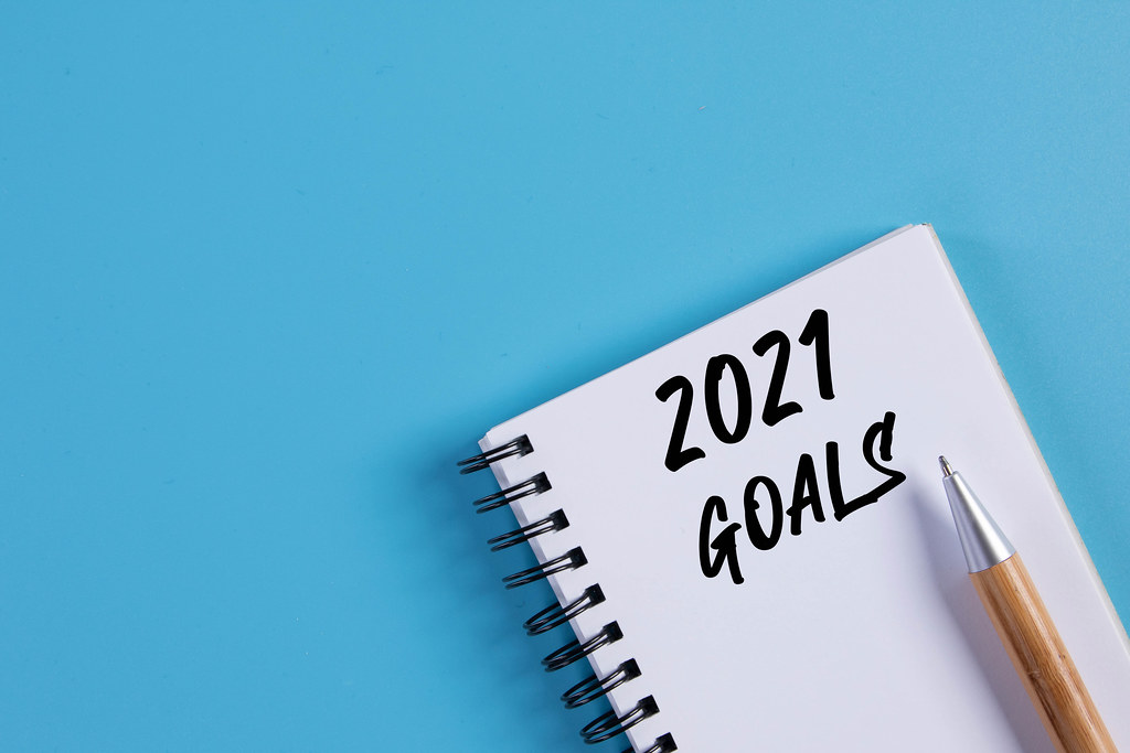 Notebook with 2021 Goals text on blue background